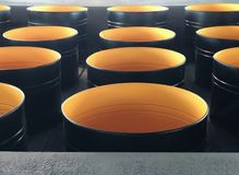 Lots of empty, open metal barrels royalty free stock images
