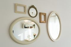 Lots of empty picture frames hung on wall. Lots of empty picture frames hung on white wall stock image