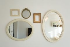 Lots of empty picture frames hung on wall. Lots of empty picture frames hung on white wall royalty free stock photos