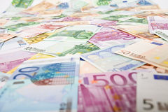 Lots of euro banknotes scattered on the table Royalty Free Stock Photography