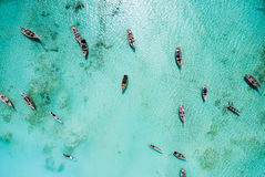Lots of fishing boats in clear ocean near Africa. Lots of fishing boats in clear turquoise ocean near Africa, top view Royalty Free Stock Image