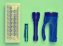 Lots of flashlights on a blue background, top view. royalty free stock photos