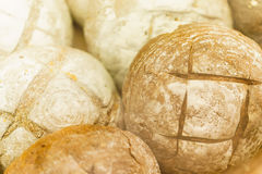 Lots of fresh bread and slices closeup. Closeup. Lots of fresh bread and slices Stock Images