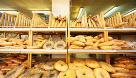Lots of fresh crisp loaves of bread in store Royalty Free Stock Photography
