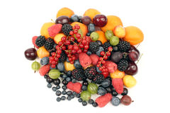 Lots of fresh different berries on a white background Stock Photos