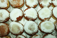 Lots of fresh donuts- view from top. Delicious, sweet, tasty donuts with suger powder on a tray Stock Images
