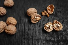 Lots of fresh nuts on a black wooden background. Best practices for designer stock image