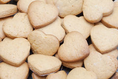 Lots of freshly baked heart shaped biscuits Stock Photo
