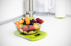 Lots of fruit on the kitchen scale Royalty Free Stock Photo