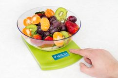 Lots of fruit on the kitchen scale Royalty Free Stock Photos