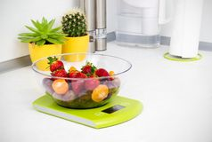 Lots of fruit on the kitchen scale Royalty Free Stock Images