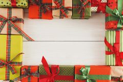 Lots of Gift boxes on white wood, christmas presents in paper Royalty Free Stock Photos