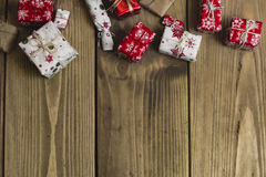 Lots of Gift boxes on wood background. Presents in craft and col Stock Photo