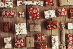 Lots of Gift boxes on wood background. Presents in craft and col Stock Images