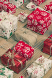 Lots of Gift boxes on wood background. Presents in craft and col Royalty Free Stock Photos