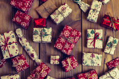 Lots of Gift boxes on wood background. Presents in craft and col Royalty Free Stock Images