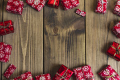 Lots of Gift boxes on wood background. Presents in craft and col Stock Image