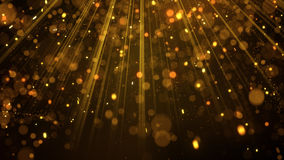 Lots of gold glitter particles in light rays Royalty Free Stock Images