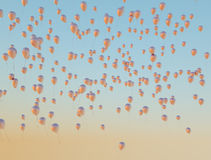 Lots of golden balloons flying up to the sky Royalty Free Stock Images