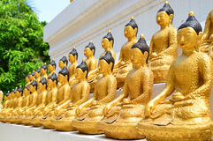 Lots of golden buddha images. On pagoda base Stock Photo