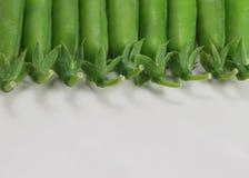 Lots grüne Erbsen Lizenzfreie Stockbilder