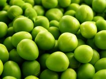 Lots of green peas Stock Photos