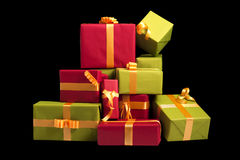 Lots of green and red presents on black background Royalty Free Stock Images