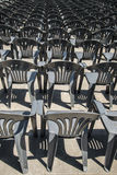 Lots of grey plastic chairs in the row Stock Photo