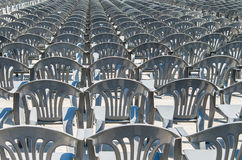 Lots of grey plastic chairs in the row Royalty Free Stock Image