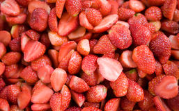 Lots of half of strawberry as background Stock Image
