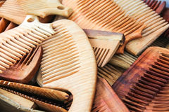 Lots of hand made wooden combs closeup Stock Photos