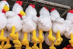 Lots of hanging toy white hens with yellow legs royalty free stock photos