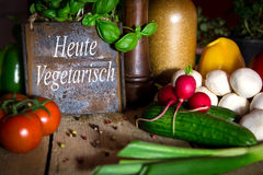 A lots of healthy vegetables on a wooden table, sign with text H Stock Photos