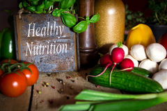 A lots of healthy vegetables on a wooden table, sign with text h Stock Image