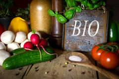 A lots of healthy vegetables on a wooden table, sign with word B Royalty Free Stock Photos