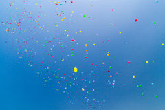 Lots of helium baloons. Houndreds of baloons flying in the sky stock photos