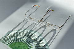 Lots of hundred Euro bills and glasses royalty free stock photography