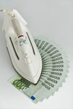 Lots of hundred Euro bills and iron Royalty Free Stock Images