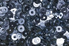 Lots of industrial galvanized steel washers. Pile of industrial steel washers for fastening stuff or crafting metal works Stock Images