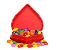 Lots of jelly beans in a red heart box Royalty Free Stock Images