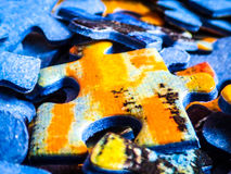 Lots of jigsaw puzzle pieces macro Stock Photography