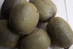 Lots of kiwi on a wooden table stock image