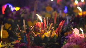Lots of krathongs floating on the water. Celebrating a traditional Thai holiday - Loy Krathong.  stock footage
