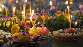 Lots of krathongs floating on the water. Celebrating a traditional Thai holiday - Loy Krathong