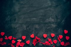Lots of little red hearts on black background. romantic love background for Valentine`s day, birthday, party, wedding. stock image