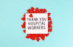 Lots of little red hearts and the inscription Thank you to hospital workers on a blue background