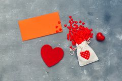 Lots of little red hearts with red card royalty free stock photo
