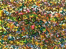 Lots and Lots of Butterflies. An abstract background realized by combining a watercolor first layer of colors over which multicolored digital butterflies were Royalty Free Stock Photography