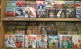 Lots of magazines on shelves. Lots of popular magazines on store shelves Royalty Free Stock Photo