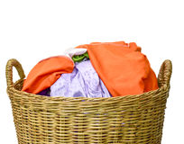Lots of many clothes with in wicker basket on white background.  royalty free stock photography